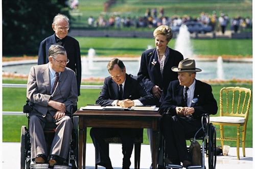 George HW Bush signs ADA